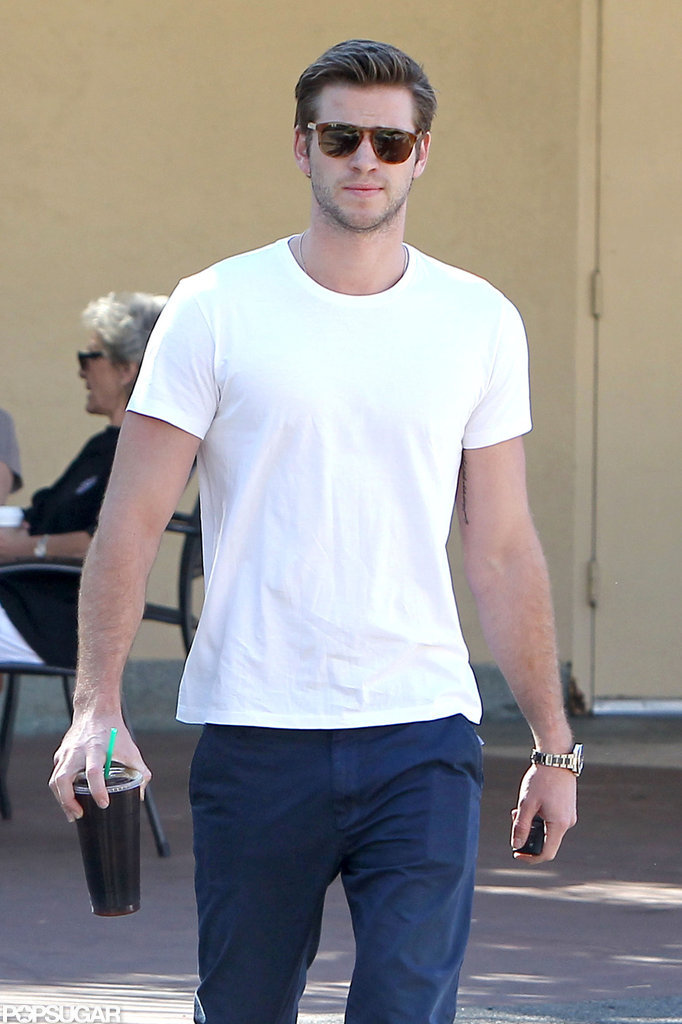 Liam Hemsworth carried an iced coffee out of Starbucks in LA.