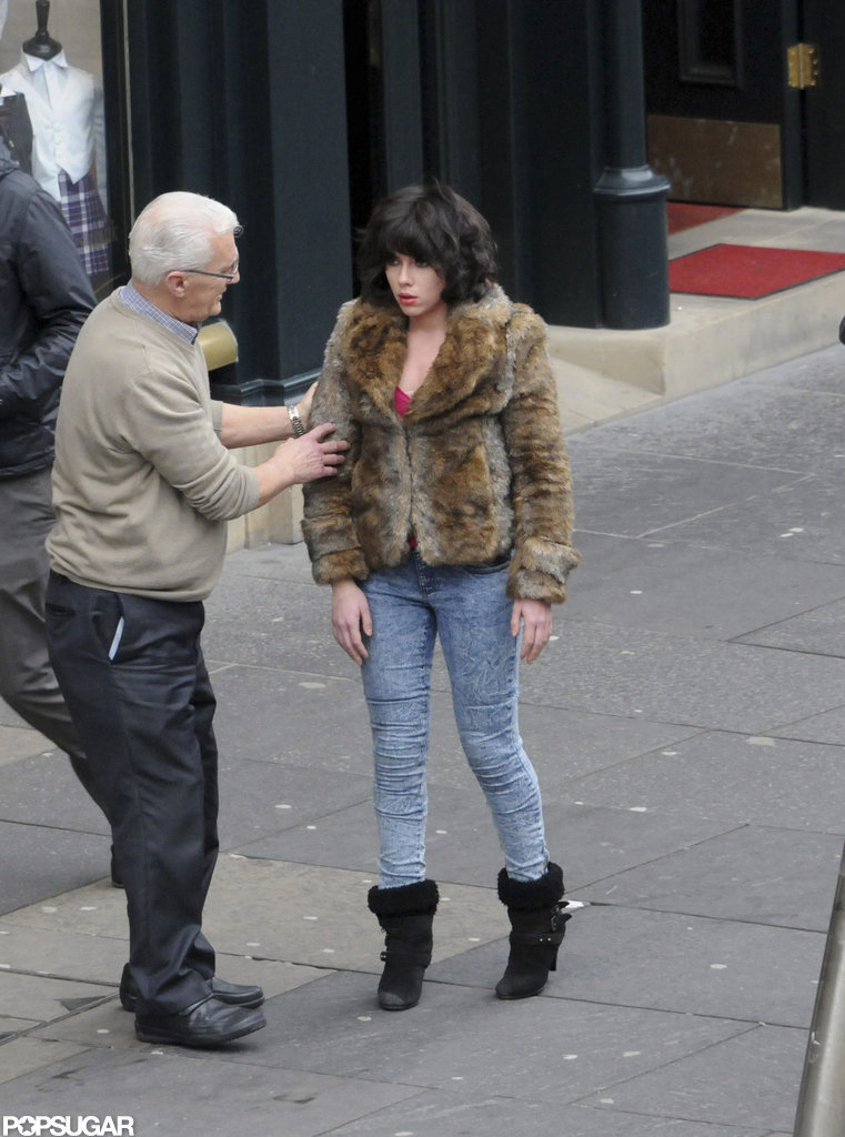 Scarlett Johansson wore a brunette wig and fur jacket on the set of Under the Skin in Scotland.
