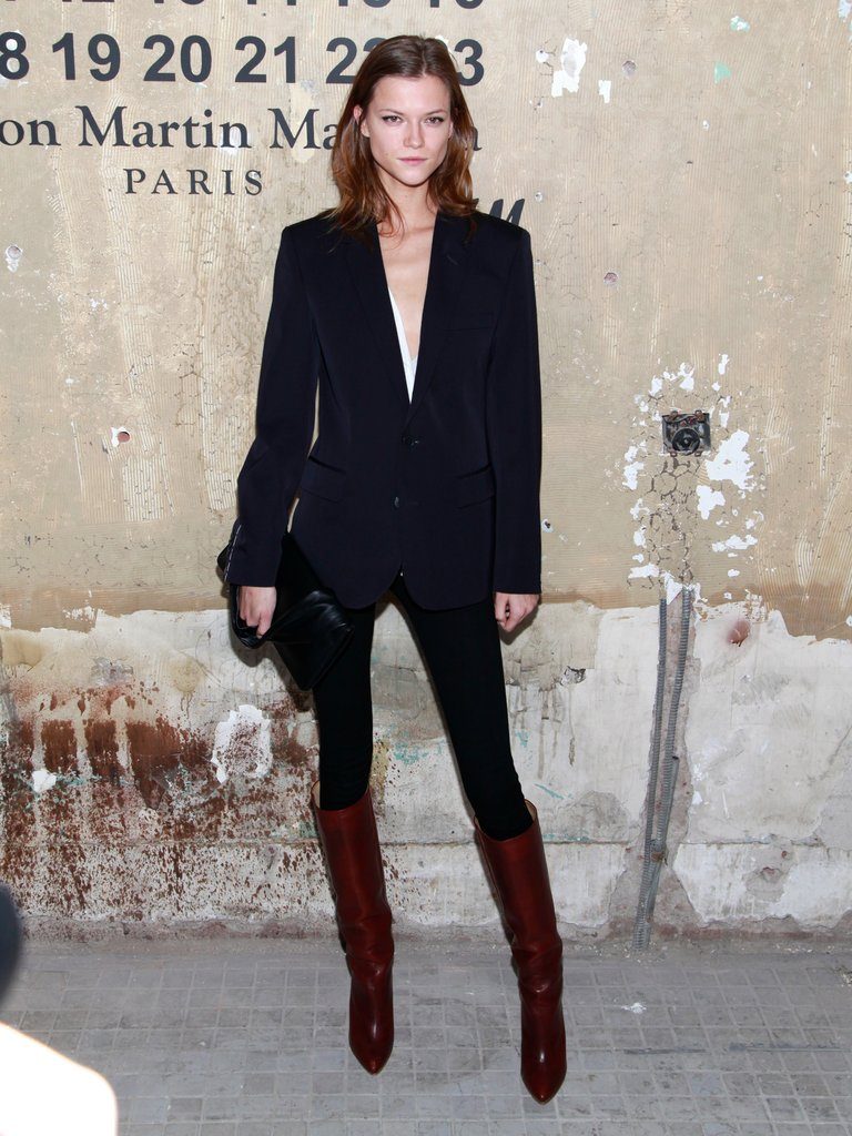 Model Kassia Struss outfitted her classic suit with a pair of equally classic knee-high boots.