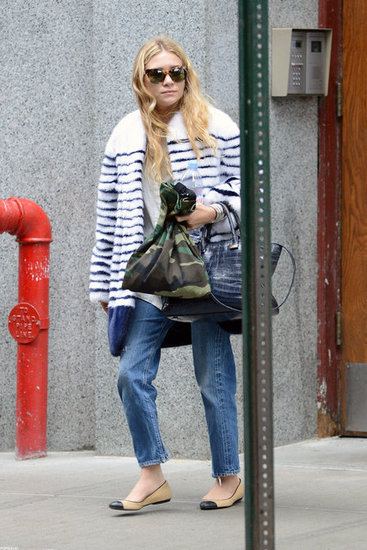 Ashley Olsen outfitted a fur coat with a chic, striped twist, then finished it off with Chanel flats and a bag from The Row.