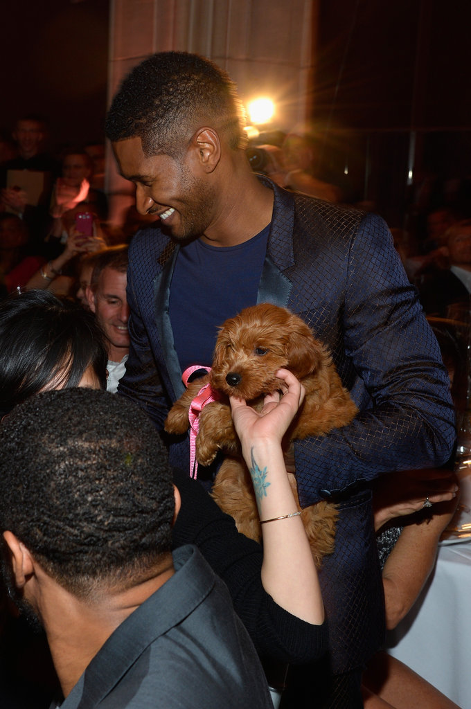 Usher carried his new puppy into the audience.