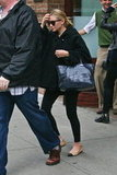 Ashley Olsen wore flats.