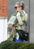 Kate Hudson carried son Bingham while out in London.