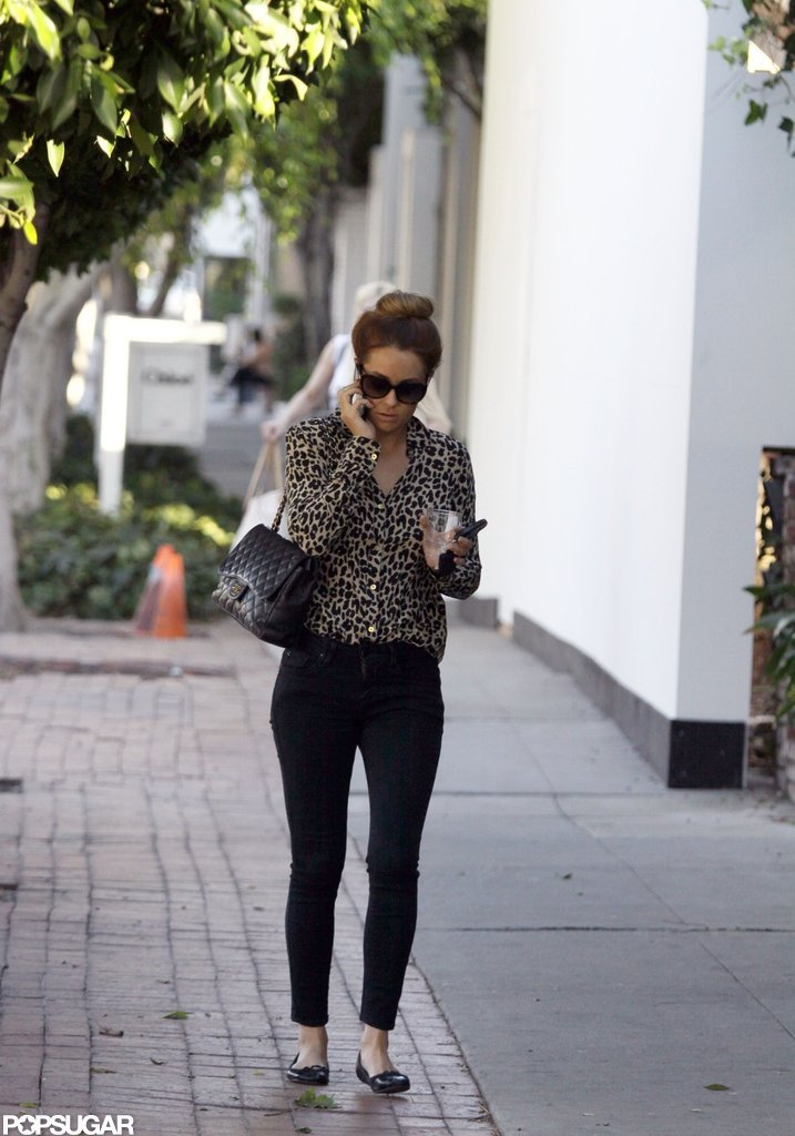 Lauren Conrad wore her hair in a high bun to shop around LA.