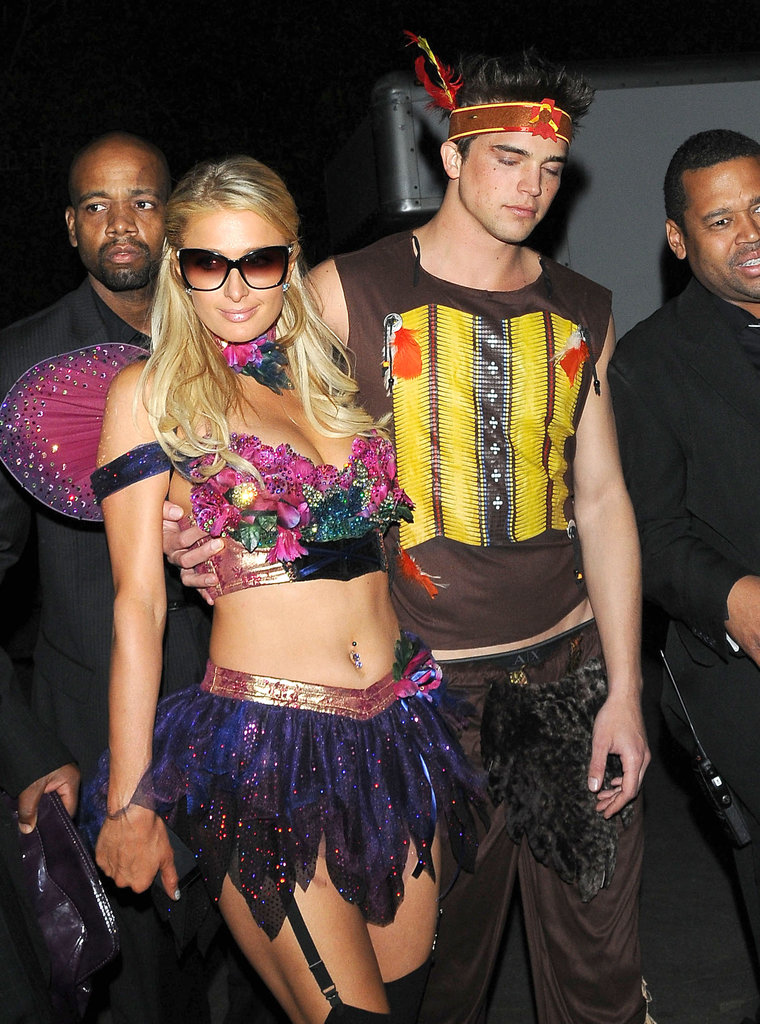 Paris Hilton stepped out in a flower-themed costume, baring her midriff and showing a lot of leg.