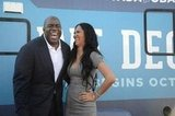 Magic Johnson and Kimmora Lee Simmons were all smiles in Nevada.  Source: Facebook User Obama for America