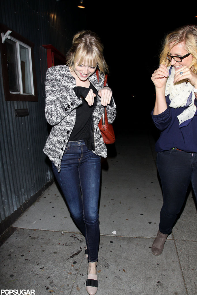 Emma Stone laughed with a friend.