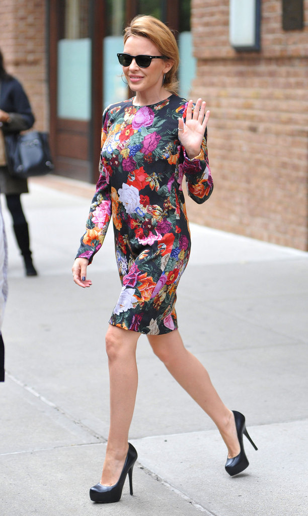 Kylie Minogue hit the streets after a movie premiere in a floral-print, long-sleeved dress by Dolce & Gabbana.