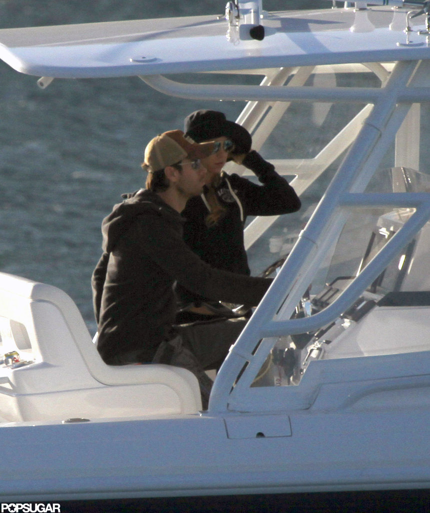 Enrique Iglesias and Anna Kournikova sat close together as they cruised around Miami.