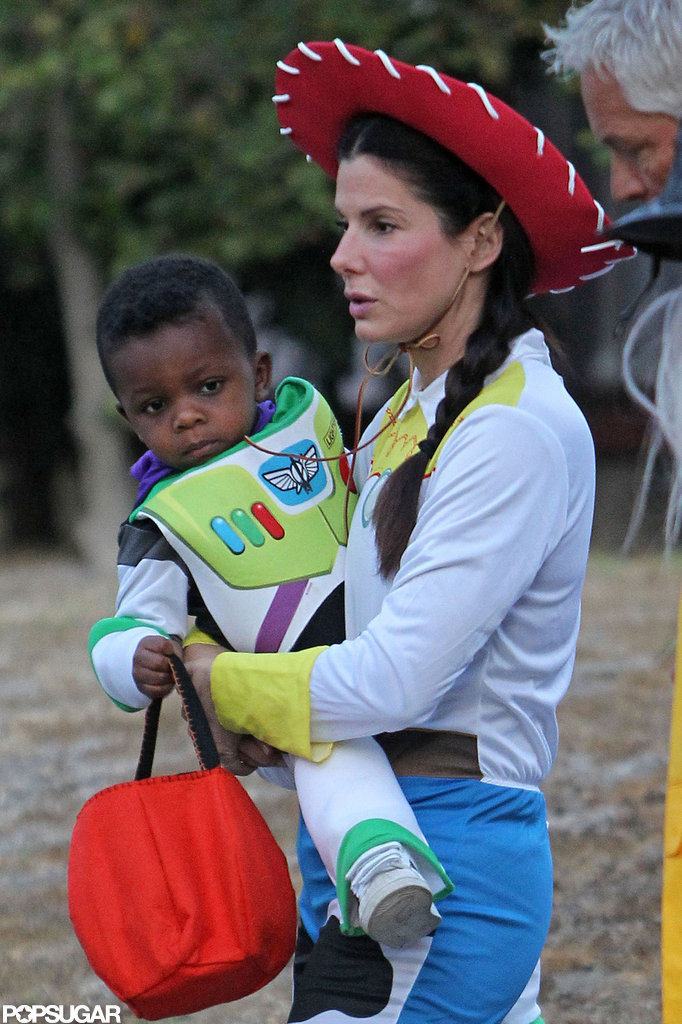 Sandra and Louis Bullock dressed up as their favorite characters from Toy Story in LA on Wednesday.