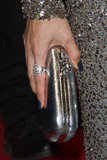 Bérénice Marlohe completed her look with a silver clutch and statement Demarco diamond ring.