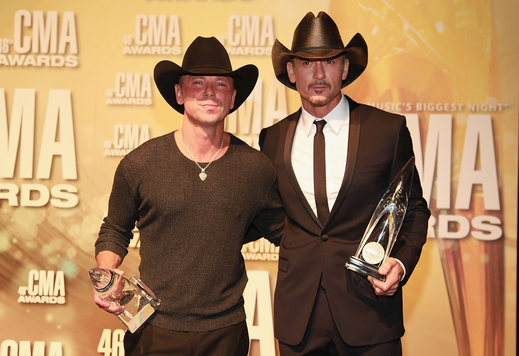 Kenny Chesney and Tim McGraw posed for photos at the Country Music Association Awards in Nashville.