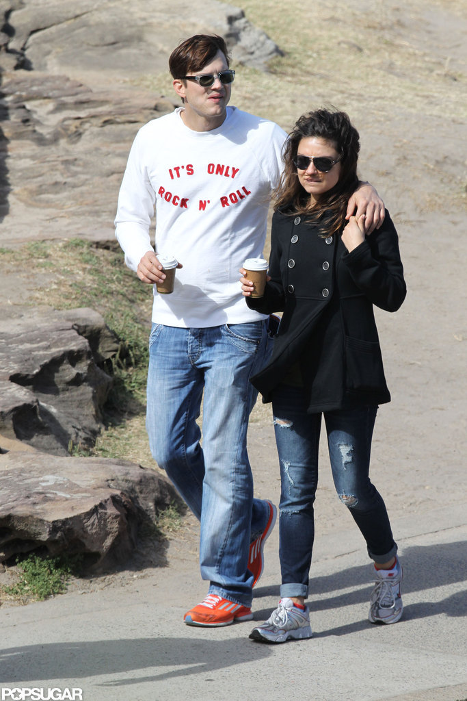 Mila Kunis wore jeans to walk with her boyfriend Ashton Kutcher in Sydney.