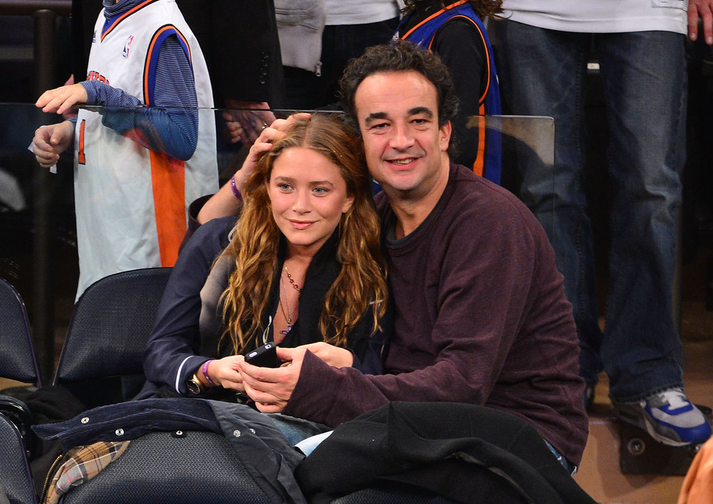 Mary-Kate Olsen and Olivier Sarkozy were affectionate at the New York Knicks game.