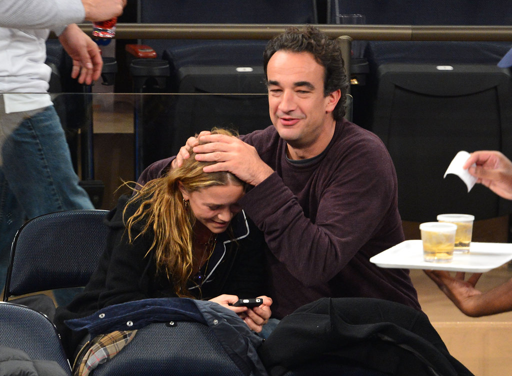 Mary-Kate Olsen and Olivier Sarkozy goofed off in the stands together.