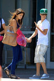 Holding hands as they left a shopping mall in June 2011.