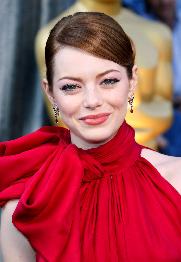 Taking color theory to a whole new level, redheaded Emma enhanced her bold red gown at the 2012 Academy Awards with sheer red lips and scintillating pink eye shadow.