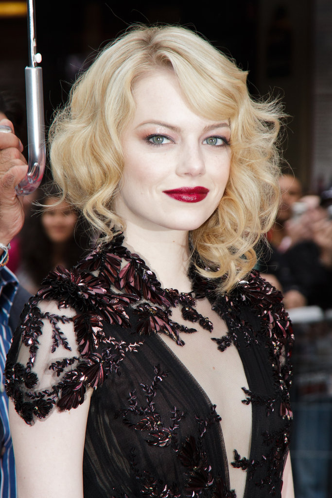 For the 2012 premiere of The Amazing Spider-Man in Paris, Emma chose romantic blond curls that formed a dark contrast with her rich berry lip look.