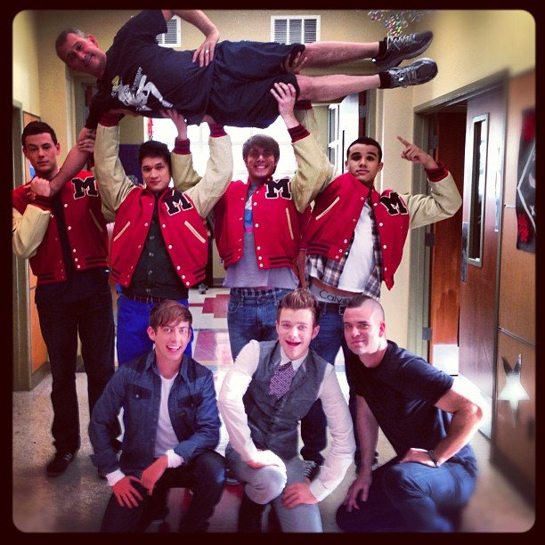 The men of Glee showed off their muscles, lifting guest director Adam Shankman. Source: Instagram user adamshankman
