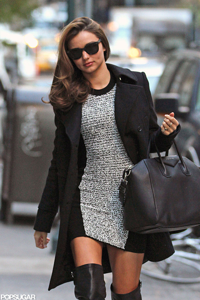 Miranda Kerr wore a fitted dress and thigh-high boots.