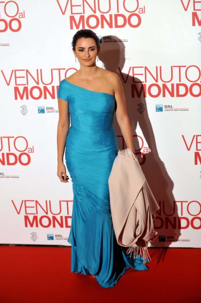 Penelope Cruz wore a blue gown for the film's premiere.