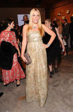 Busy Philipps wore a strapless gold printed gown paired with turquoise jewels.