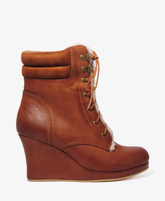 If you're on the fence about this trend, this utilitarian Forever 21 Faux Shearling Wedge Boot ($37) won't break your budget.