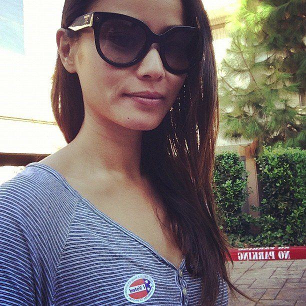 Jamie Chung wore a patriotic ensemble of a blue striped shirt to complement her voter's pin. Source: Instagram user JamieChung