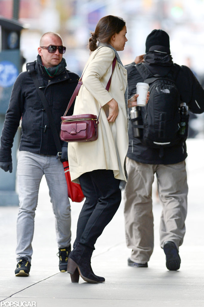 Katie Holmes kept warm in a long coat.
