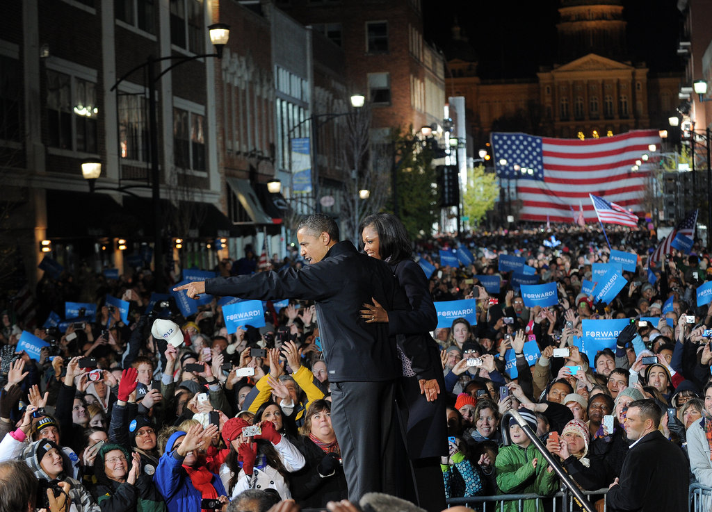 The happy couple warmly greeted voters during their last rally.