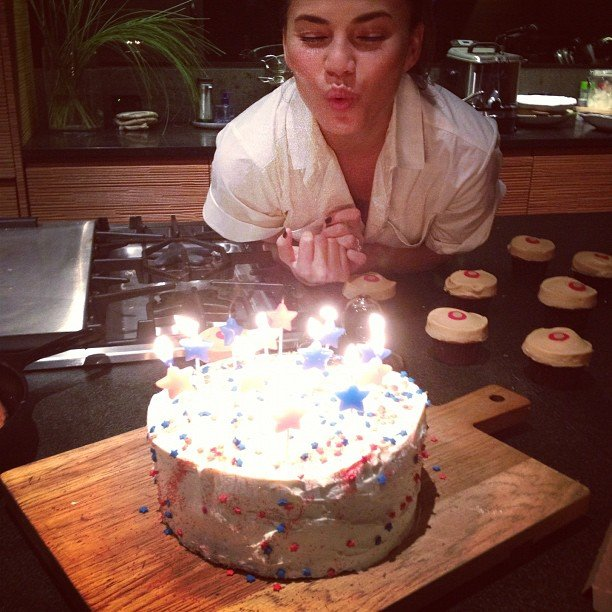 "Chrissy Teigen blew out the candles on her homemade ""Obamacare-rot cake."" Source: Instagram user chrissy_teigen"