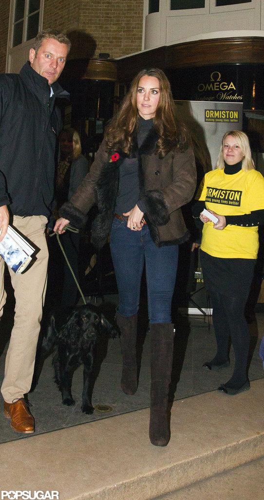 Kate Middleton led Lupo back to her car.