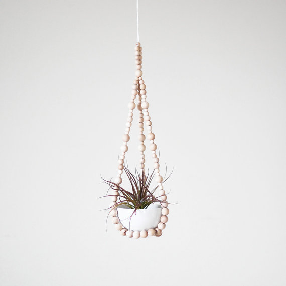 For the bohemian in your life, this Small Beaded Plant Hanger ($38) looks especially chic when mixed with modern airplants or succulent varities.