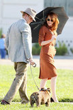 Ryan Gosling and a cute pup put a smile on Emma's face while filming a scene for Gangster Squad.