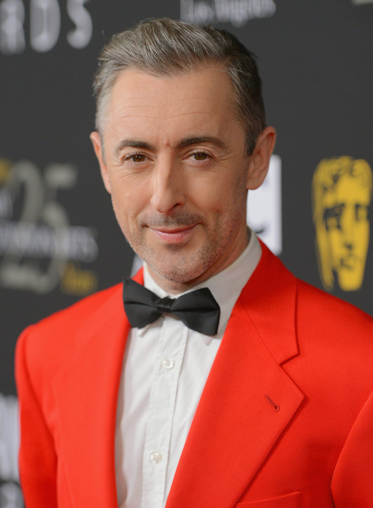 Alan Cumming rocked a brightly coloured suit on the red carpet.