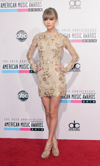Taylor Swift's gold Zuhair Murad number featured the kind of intrigue we're currently feeling: gold beading details that give the singer an extraglamorous edge.