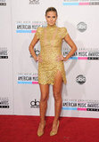 Heidi Klum hit the red carpet in a sexy gold number by Alexandre Vauthier with a thigh-high slit — but it was the lace embellishment and subtle gold tone that really caught our eye.