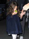 Suri Cruise snacked on a green apple.
