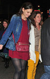 Katie Holmes left her show in a denim jacket and red dress.