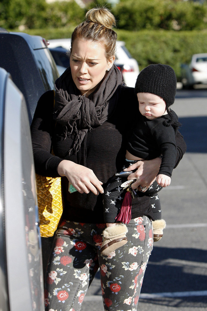 Hilary Duff styled her hair in a high bun while Luca Comrie kept warm in a hat.