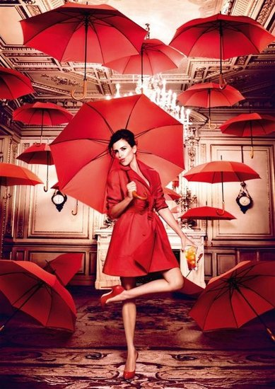Penélope Cruz opened umbrellas indoors for the Campari calendar.