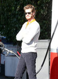 Andrew Garfield waited at a gas pump.