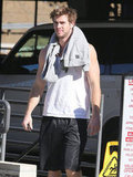 Liam Hemsworth showed off his arms in a tank.