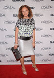 Diane von Furstenberg glowed in her own printed top and metallic pencil skirt.