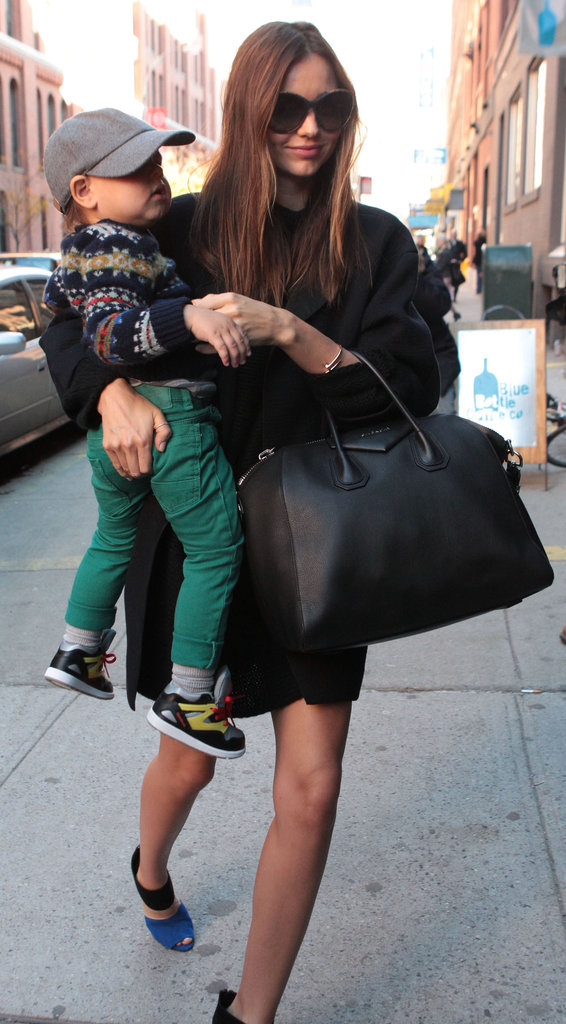 Miranda Kerr stepped out in NYC carrying her son, Flynn.