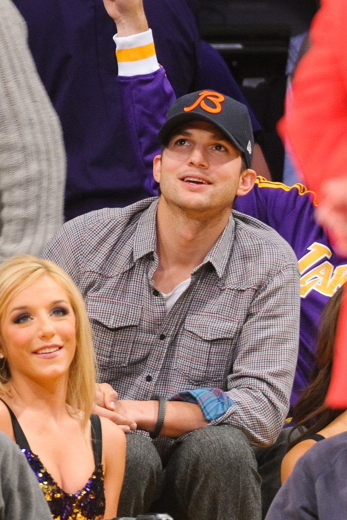 Ashton Kutcher checked the scoreboard.