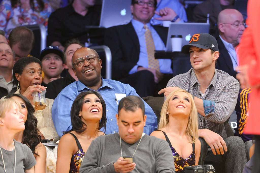 Ashton Kutcher joked around with a fan next to him.