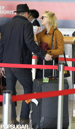 Carey Mulligan and Marcus Mumford waited in LA at LAX.