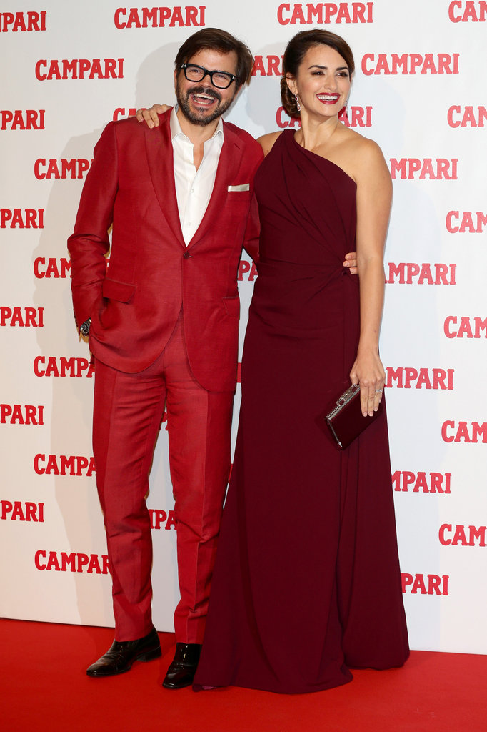 Penelope Cruz smiled and posed in a burgundy one-shouldered dress in Milan.