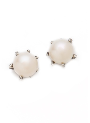 Lauren Wolf's Overized Stud Earrings ($132) are the perfect modern take on pearl earrings.